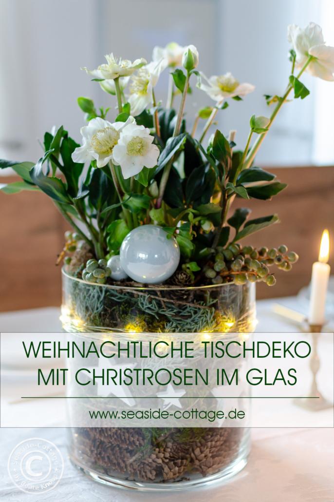 Pinterest Pin Weihnachtliche Tischdeko mit Christrosen im Glas