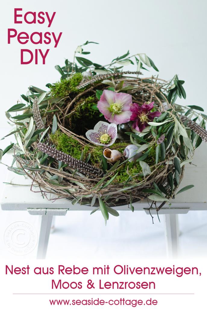 Pinterest Pin für Nest aus Rebe mit Olivenzweigen, Moos und Lenzrosen