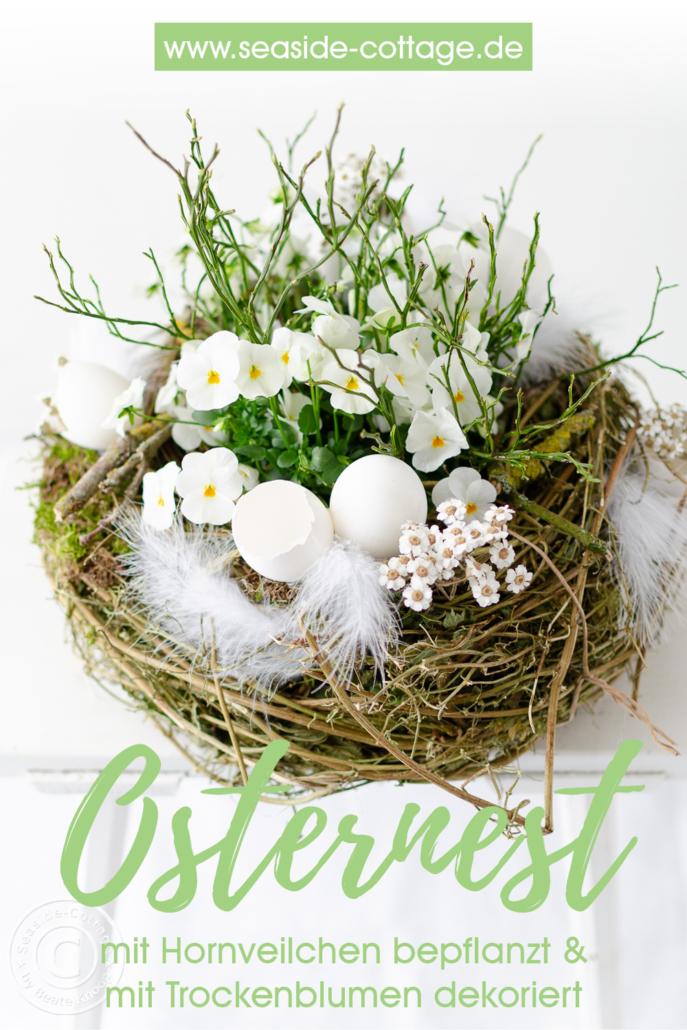 Pinterest Pin bepflanztes Osternest mit Hornveilchen