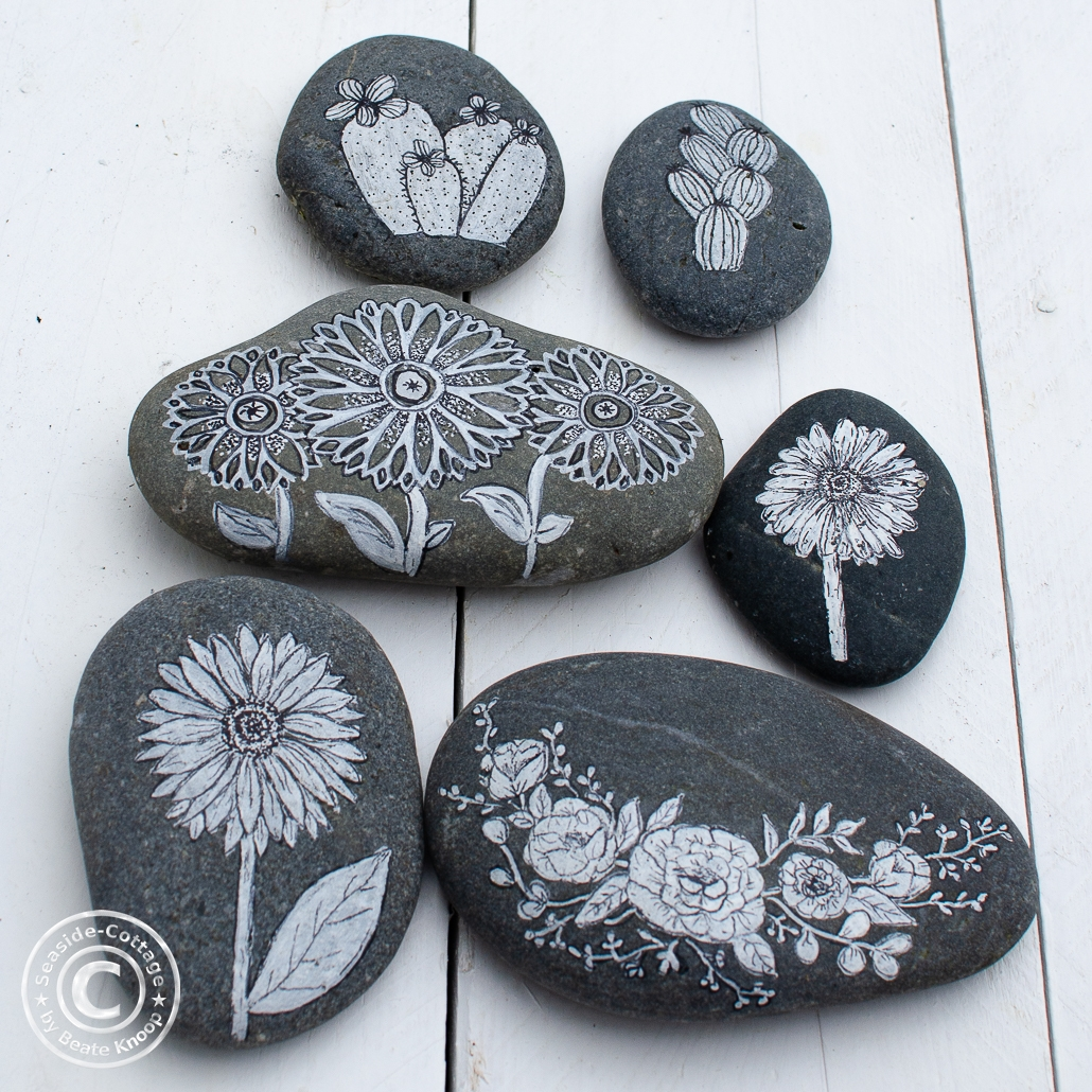 Blumen zum Muttertag, zum Beipsiel auf bemalten Steinen